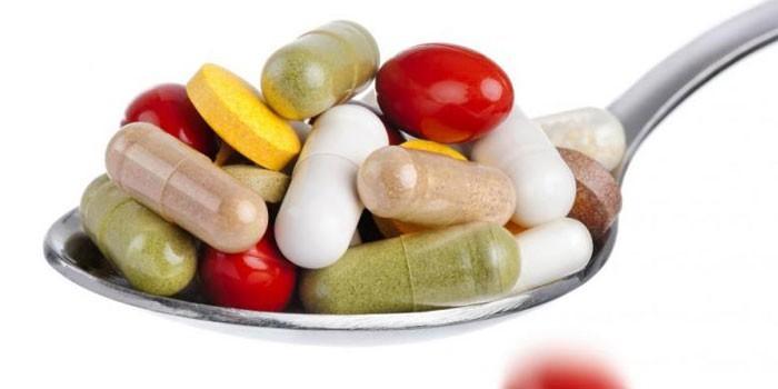 таблетки в ложке